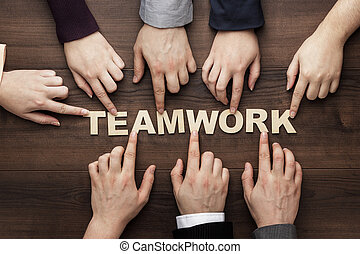 teamwork concept on the brown wooden table background -...