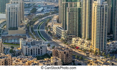 Top view of road in Dubai downtown timelapse with day...
