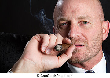 Man Smoking Cigar - Handsome businessman smoking cigar