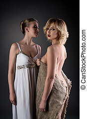 Lady wearing dress and woman dressed in rags - Concept. Lady...