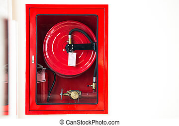 Fire safety equipment in the red box on wall cement