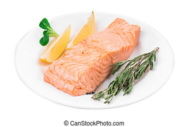 Fried salmon fillet on plate with lemon. Isolated on a white...