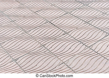 Wave pattern of stone tile on the pavement in urban park