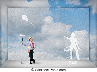 Happy childhood - Cute girl of school age painting wall with...