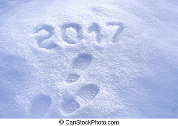 Foot step prints in snow, New Year 2017 greeting