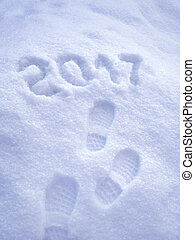 Foot step prints in snow, 2017 New Year greeting card