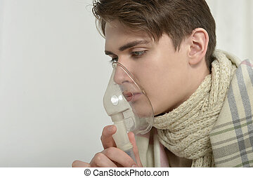 Man Inhaling Through Inhaler Mask