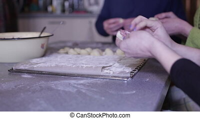 Female hand mold dumplings - Female and male hands put the...