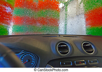 Automatic car wash. View from the car of a passing car...