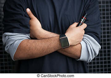 Black man with smart watches and vaporizer - Hands of...