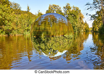 Levitating sphere - About a romantic river floats a...