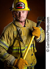 Firefighter holding axe