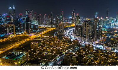 Scenic aerial view of a big modern city at night timelapse....