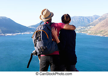 Loving young couple on holiday looking at beautiful view