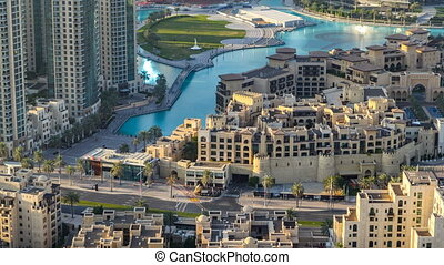 Top view of the bridge over man-made lake timelapse in Dubai downtown, United Arab Emirates.