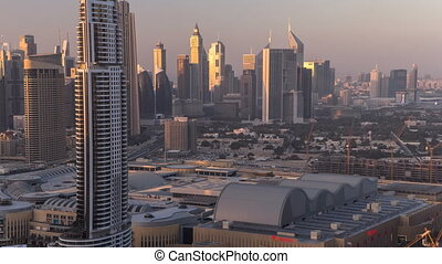 Scenic Dubai downtown skyline day to night timelapse Rooftop...
