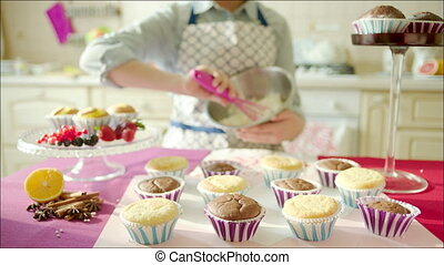Woman practises at home bakery - Shot focused on woman...