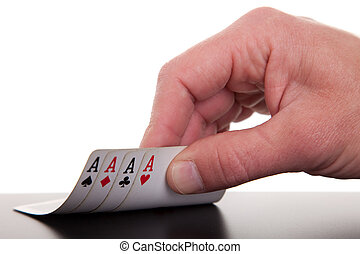 mans hand revealing four aces, isolated on white background,...