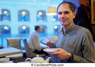 Mature man drinking tea