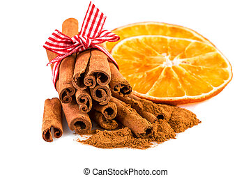 Dried orange slices with cinnamon sticks and cinnamon powder...