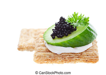 Caviar on crackers - Canape with cream cheese and caviar...