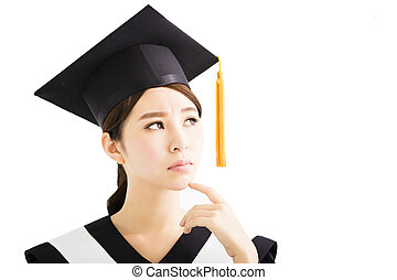 young female  graduation student looking up and thinking