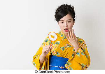 woman wearing Yukata - young attractive Japanese woman in a...