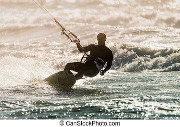 Kitesurfer in action on a beautiful background of spray...