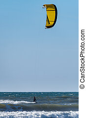 Kite Surfer - Kiteboarder enjoy surfing on a sunny day.