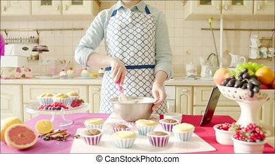 Woman working dough to a recipe on - Shot of woman standing...