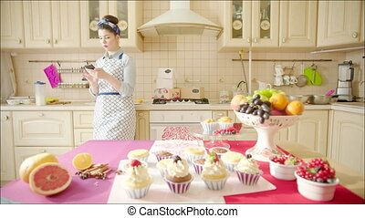Woman checking cakes in oven - Shot of delicious cakes...