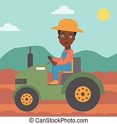 Farmer driving tractor - An african-american woman driving a...