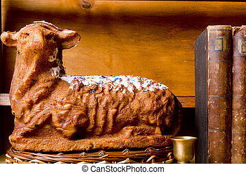 Easter cake in the form of a lamb on a wooden background
