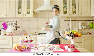 Woman dancing while cooking - Shot of woman dancing in the...