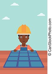Constructor with solar panel - An african-american woman...