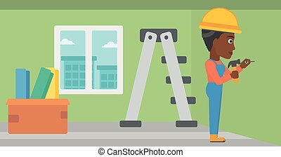 Constructor hammering nail - An african-american woman...