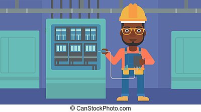 Electrician with electrical equipment - An african-american...