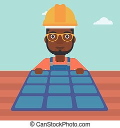 Constructor with solar panel - An african-american man...