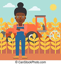 Woman standing with combine on background - An...