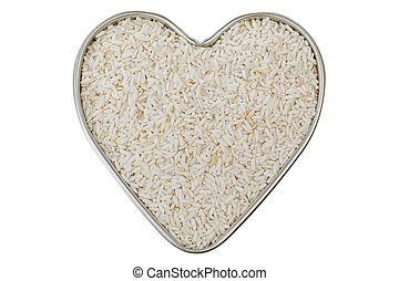 Heart shaped tin pan full of raw white Sticky rice,...