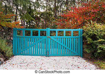 Blue gate against autumn background - Blue gates against...