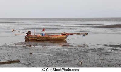 boat wreck lying on the sand - Fishing boat wreck lying on...