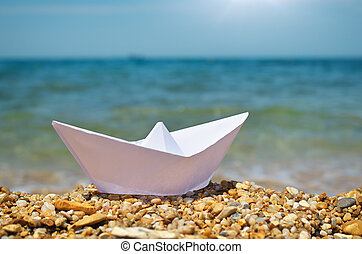 Origami ship on the sea.