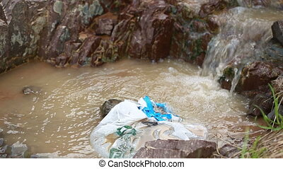 Pollution river. plastic bag in the river