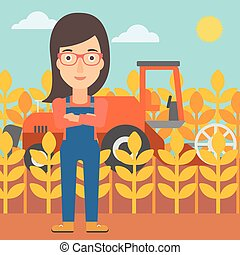Woman standing with combine on background - A woman standing...