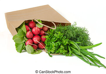spring vegetables in papper package on white background