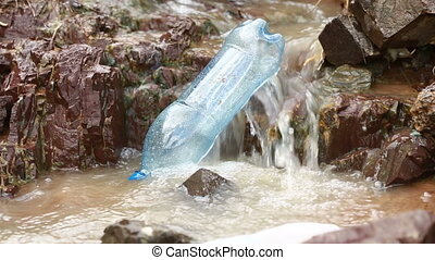 The thrown bottle floats in the river environmental...