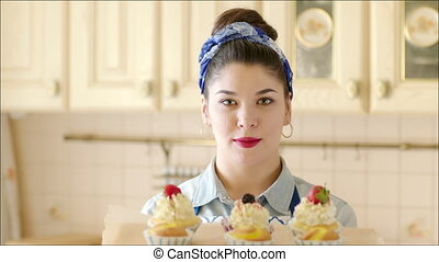 Young girl presenting cakes - Close up shot of a young...