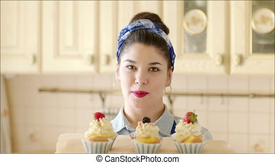 Happy smiling girl showing cakes - Close up shot of a young...