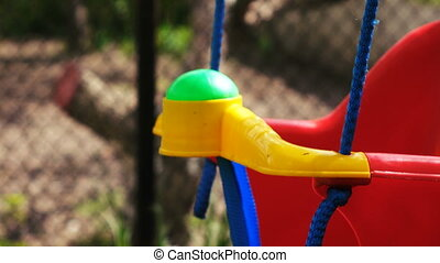 Children swing on tree - Red plastic swing on tree